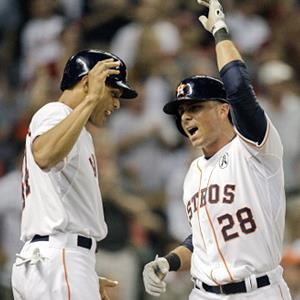 Rick Ankiel & Matt Dominguez of the Houston Astros high-five after hitting a home run against the Texas Rangers in Houston on Sunday (© Bob Levey/Getty Images)