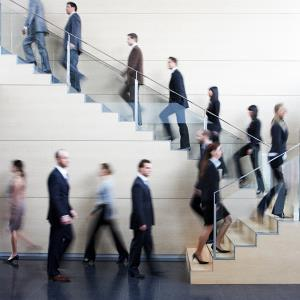 Businesspeople using stairwell (© Tom Merton/OJO Images/Getty Images)