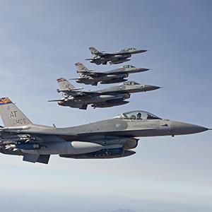 F-16's from the Air National Guard Air Force Reserve Test Center fly in formation during a test mission (© HIGH-G Productions/Stocktrek Images)