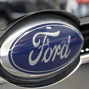 Ford logo on the grill of a Ford F-150 truck at the 2013 Pittsburgh Auto Show (© Gene J. Puskar/AP Photo)