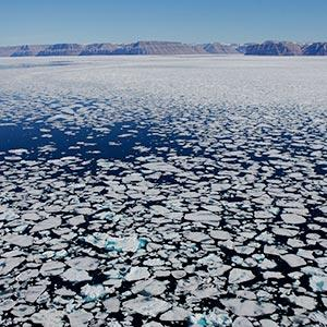 Ice breaking at the Arctic Bay ice floe edge (Paul Nicklen/National Geographic/Getty Images)