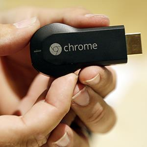 The new Google Chromecast device is shown on July 24, 2013, in San Francisco, Calif. (copyright Marcio Jose Sanchez/AP Photo)