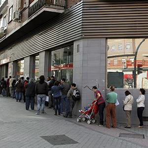 People wait in line outside an office to register for job placement in Madrid, Spain on April 25, 2013 (© Andres Kudacki/AP Photo)