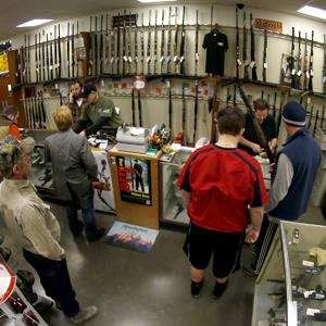 File photo of customers at the gun counter in Duke's Sport Shop on Jan. 15, 2013, in New Castle, Pa. (© Keith Srakocic/AP Photo)