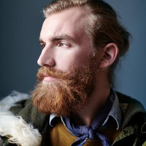 Portrait of red haired man with beard