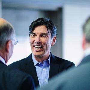 Tim Armstrong, CEO of AOL., center, talks with attendees before speaking at the Society of American Business Editors and Writers (SABEW) 2013 Spring Conference in Washington, D.C., on April 4, 2013 (© Pete Marovich/Bloomberg via Getty Images)