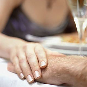 Image: Couple holding hands (© Corbis/Corbis)
