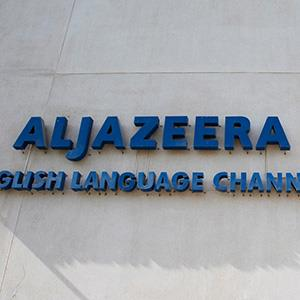 Al Jazeera sign on office builiding (© Fadi al-Assaad/Reuters)