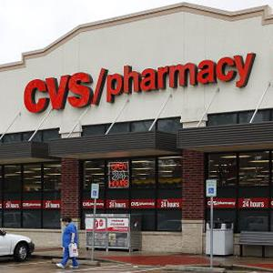 A woman carries a bag as she leaves a CVS store in Houston, Texas, U.S., on Tuesday, Dec. 8, 2009 (Aaron M. Sprecher/Bloomberg via Getty Images)