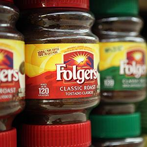 Packages of Folgers coffee are displayed on a shelf at Cal-Mart Market on May 24, 2011 (© Justin Sullivan/Getty Images)