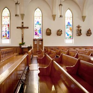 Pews and stained glass windows in church (© Monashee Frantz/OJO Images/Getty Images)