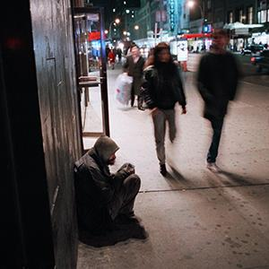 File photo of a homeless man in New York City (© Mark Lennihan/AP Photo)