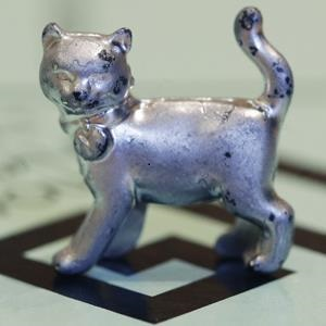 The newest Monopoly token, a cat, rests on the game board at Hasbro Inc. headquarters in Pawtucket, R.I. on Feb. 5, 2013 (Steven Senne/AP Photo)