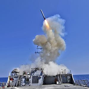 U.S. Navy guided-missile destroyer USS Barry (DDG 52) launches a Tomahawk cruise missile in support of Operation Odyssey Dawn March 29, 2011 from the Mediterranean (© U.S. Navy via Getty Images)