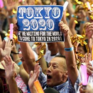 People celebrate after Tokyo is selected as the host city for the 2020 Olympic and Paralympic Games on September 8, 2013 in Tokyo (© Asahi Shimbun via Getty Images)
