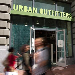 Pedestrians walk past the Urban Outfitters Inc. store in San Francisco, Calif. (© David Paul Morris/Bloomberg via Getty Images)