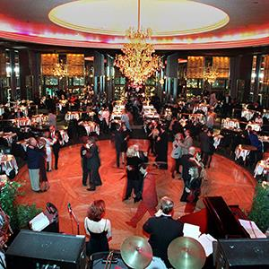 Guests at New York's Rainbow Room dance on the revolving floor of the restaurant and nightclub on Dec. 17, 1998 (© Suzanne Plunkett/AP Photo)