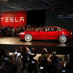Tesla Motors CEO Elon Musk drives a Model S at the Tesla factory (© Stephen Lam/Newscom/Reuters)