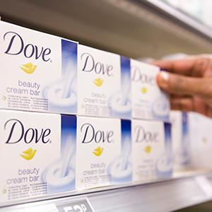 A customer selects bar of Dove soap (© Chris Ratcliffe/Bloomberg via Getty Images)