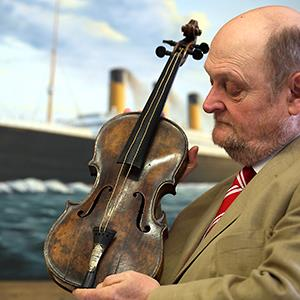Auctioneer Alan Aldridge holds the violin of Wallace Hartley, the band leader of the Titanic. Matt Cardy/Getty Images