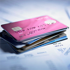 Close up of stack of credit cards © Adam Gault, OJO Images, Getty Images