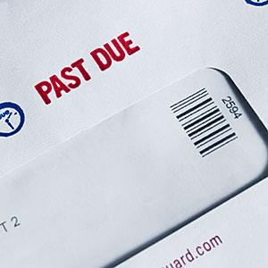 Past Due Notice on Envelope © Stockbyte/Getty Images