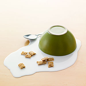 Image: Bowl of Spilled Milk and Cereal (© David Arky/Corbis)