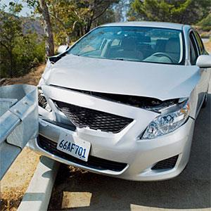Car wrecked on road guardrail © NULL, OJO Images, Getty Images