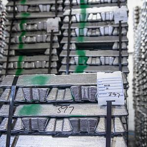 Credit: © Monty Rakusen/CorbisCaption: Stacked aluminum ingots in warehouse