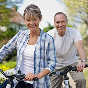Portrait of smiling senior couple on bicycles -- Robert Daly, OJO Images, Getty Images