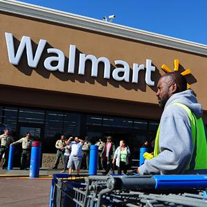 A Walmart employee gathers pushcarts at a Walmart store in Paramount, Calif. (© Frederic J. Brown/AFP/Getty Images)