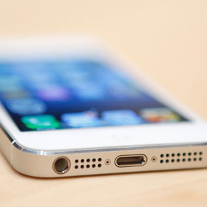 The iPhone 5 is displayed during a media event on September 12, 2012. Copyright: BECK DIEFENBACH, Newscom, RTR