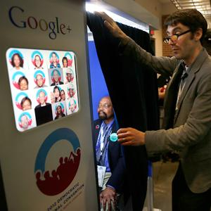 A delegate sits in the Google Inc. photobooth during day two of the 2012 DNC in Charlotte. Copyright: Victor J. Blue, Bloomberg via Getty Images