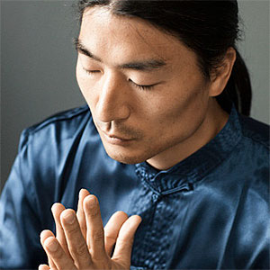 Korean man praying. Copyright: Blend Images, Hill Street Studios, Blend Images, Getty Images