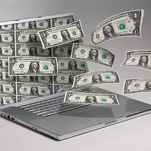 Image: Money and computer. Copyright: Angel Muniz, Jupiterimages.