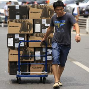 Lenovo computers being readies for shipment from a Beijing manufacturing plant © Nelson Ching/Bloomberg via Getty Images