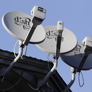 Three Dish Network satellite dishes at an apartment complex in Palo Alto, Calif. (© Paul Sakuma/AP Photo)