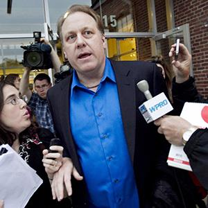 Curt Schilling is questioned by reporters about a lawsuit over the $75 million loan for Schilling's video game company in Providence, R.I. on May 21, 2012 (copyright Steven Senne/AP Photo)