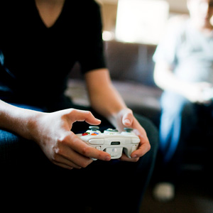 Boys playing video games  Image Source/Getty Images