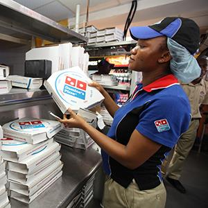 Domino's Pizza worker in Lagos, Nigeria Source: © Sunday Alamba/AP Photo