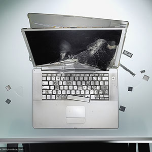 Image: Damaged laptop (© Jason Stang/PHOTOLIBRRAY/Photo Library)