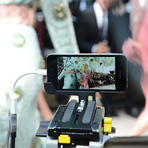The iPhone 5S is used for filming and broadcasting during the Burberry Prorsum show, Spring Summer 2014 during London Fashion Week on Sept. 16, 2013 (© Richard Young/Rex Features)