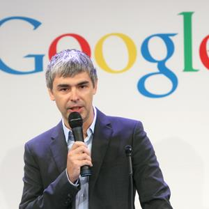Google CEO Larry Page speaks at a news conference at the Google offices in New York in 2011 © Seth Wenig/AP