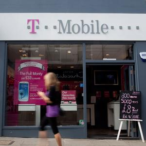 A pedestrian passes a T-Mobile store, operated by Deutsche Telekom AG, in Guildford, U.K © Simon Dawson/Bloomberg via Getty Images