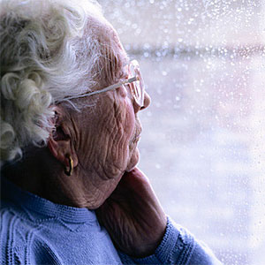 Elderly Woman Looking Out a Window -- Keith Brofsky, Photodisc, Getty Images