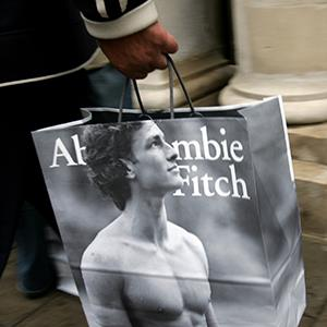 A shopper leaves the Abercrombie & Fitch UK Flagship Store on Savile Row in London, England (© Gareth Cattermole/Getty Images)