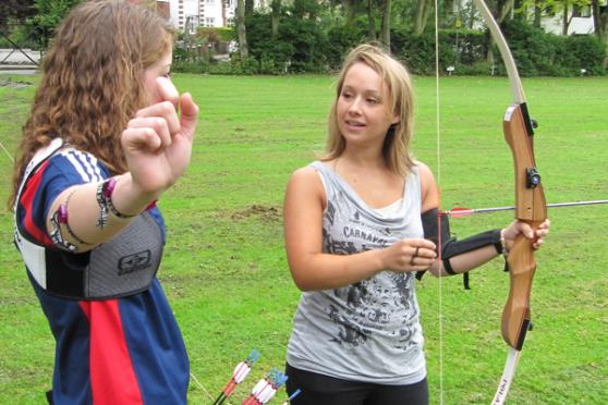 Becky Martin gives Emma Roberts some advice to help her archery skills.