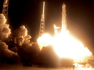 Lift off of the Falcon 9 rocket carrying the Dragon capsule.