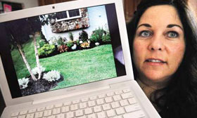 Kimberly Bois holds a computer showing the flowers she planted at her condo in Portsmouth, N.H. 