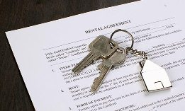 Rental agreement and keys (© fStop/SuperStock)
